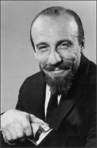 Mitch Miller in his hey day. He hated both jazz and rock, passed on Elvis and Buddy Holly.